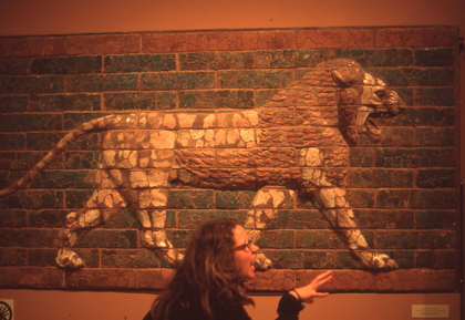 Elena in front of a Babylonian bas-relief terra cotta panel (c.1,300 BC) at the Oriental Institute.