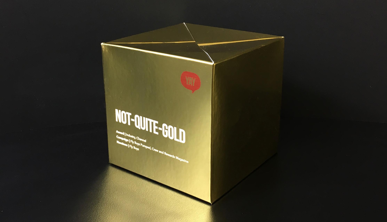 DM_pop-up-cube-gold-YAY_LR.jpg