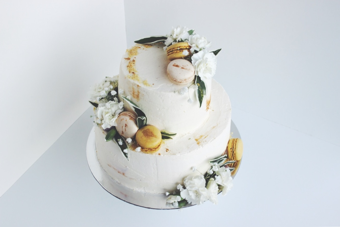Gold and white engagement cake with two tiers of chocolate cake, chocolate ganache and nutella whipped cream.
