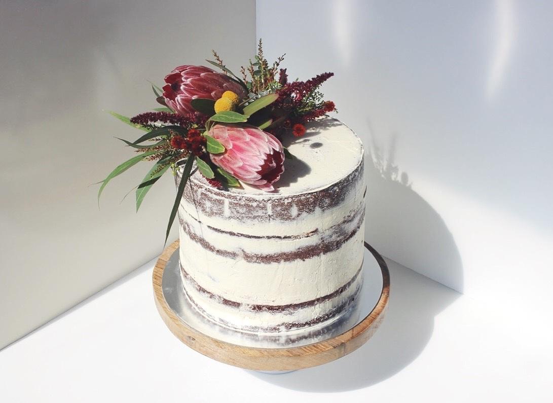 Two-tiered, chocolate semi-naked cake with dark chocolate ganache
