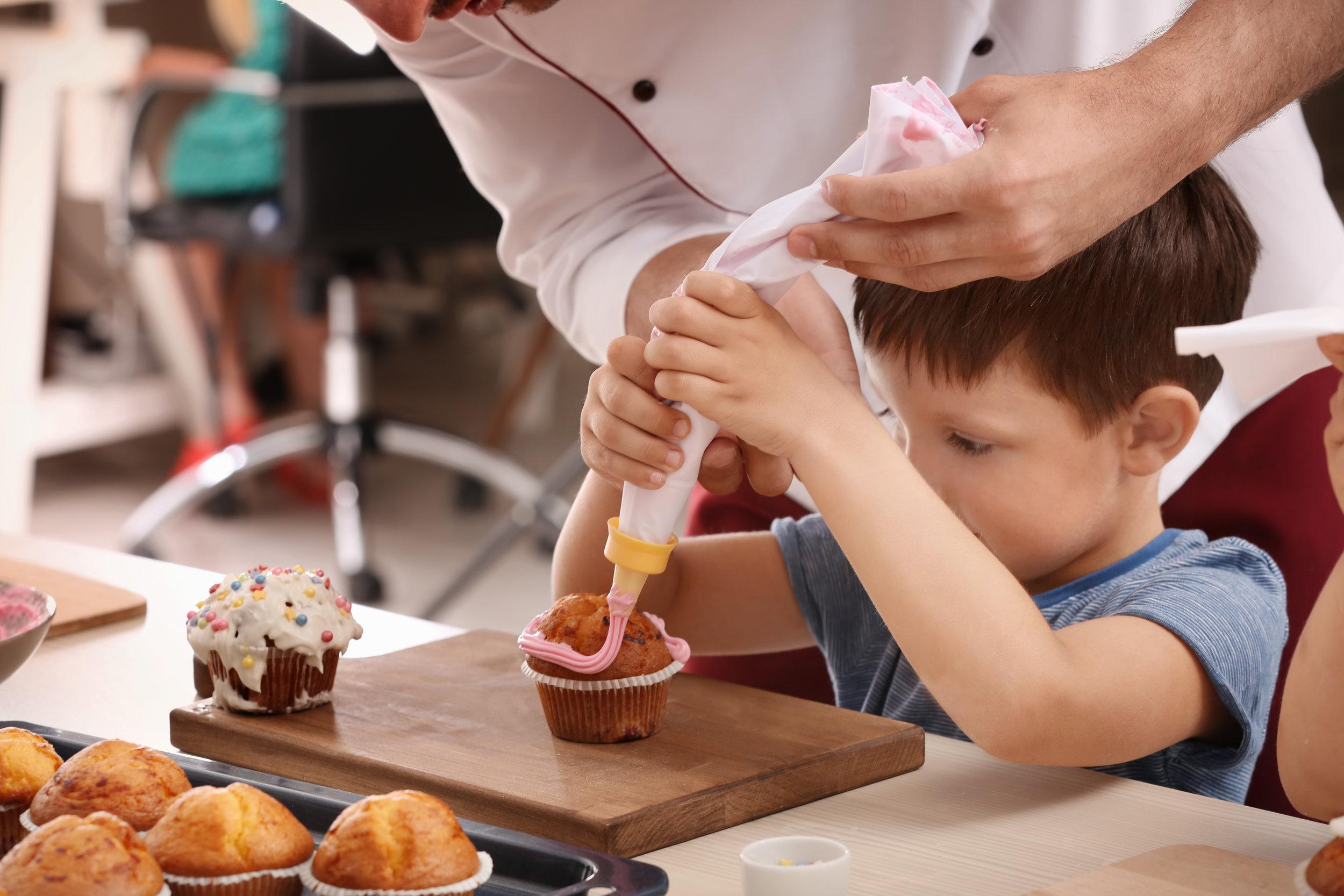 Each day, preschool children help prepare snacks for tea time.