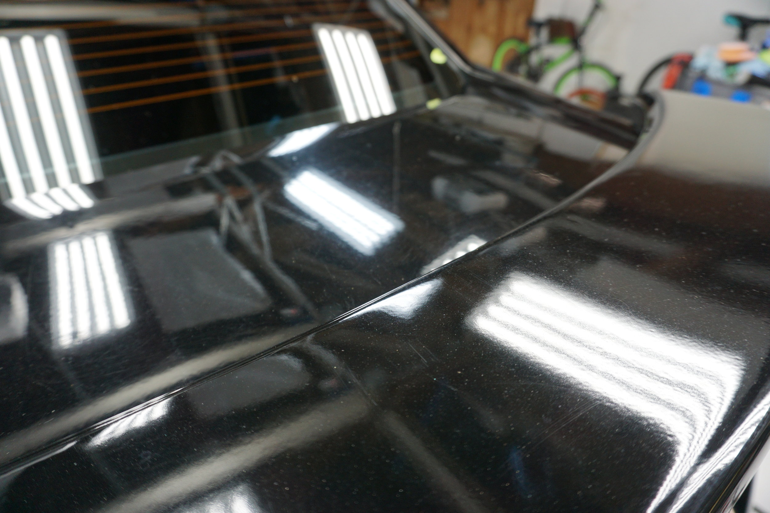 Aftermarket spoiler and paint - it needs to be wet sanded to match but it isn't in the budget