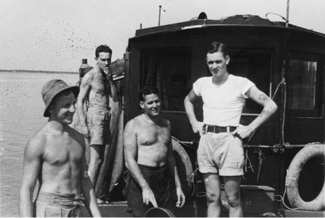 A group from Z Special Unit on board MV Krait during Operation Jaywick Left to right B3312 AB Andrew William George Huston RAN  66175 Major Ivan Lyon MBE  The Gordon Highlanders officer commanding .jpg