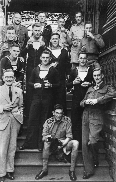 Informal group portrait of personnel connected with Operation Jaywick back row left to right Maj Herbert Alan Campbell did not accompany the expedition B2575 Leading Stoker James Patrick McDowell RN uni.jpg