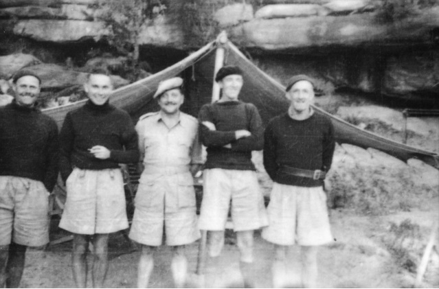 Five members of SOE Australia aka Inter Allied Services Department or IASD outside a tent at a training camp Left to right are Chester  Ivan Lyon  Jock Campbell  Reynolds _ Davidson.jpg