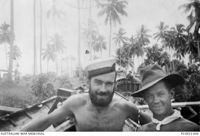 Informal portrait of PA/2957 Telegraphist Ronald James Reynolds (left) and Leading Seaman Clayton, crew members of Harbour Defence Motor Launch (HDML) 1321, at Coast Watcher Camp Alexshafen, New Guinea, just prior to the ill fated raid on Muschu Island, off the coast of New Guinea, on 11 April 1945.
