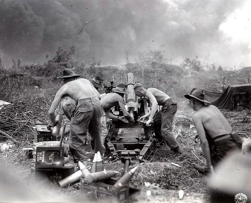 Australian Gunners of the 2/4th Field Regiment, RAA 71st Infantry Division were fired on the Japanese with a short version of the British 25 Pounder gun during the invasion of the island of Borneo in the Dutch East Indies July 1945