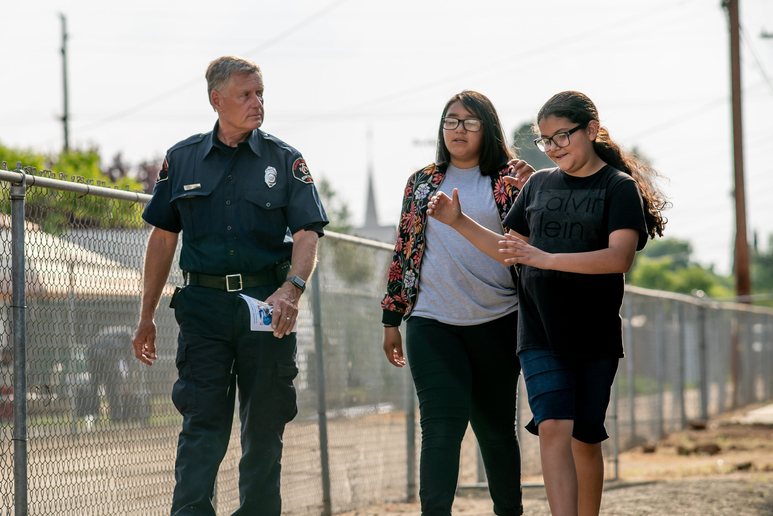 David Drum from the Tulare County Fire Department, walks with members Melhaney & Jazmyne as they guide him around the Club.