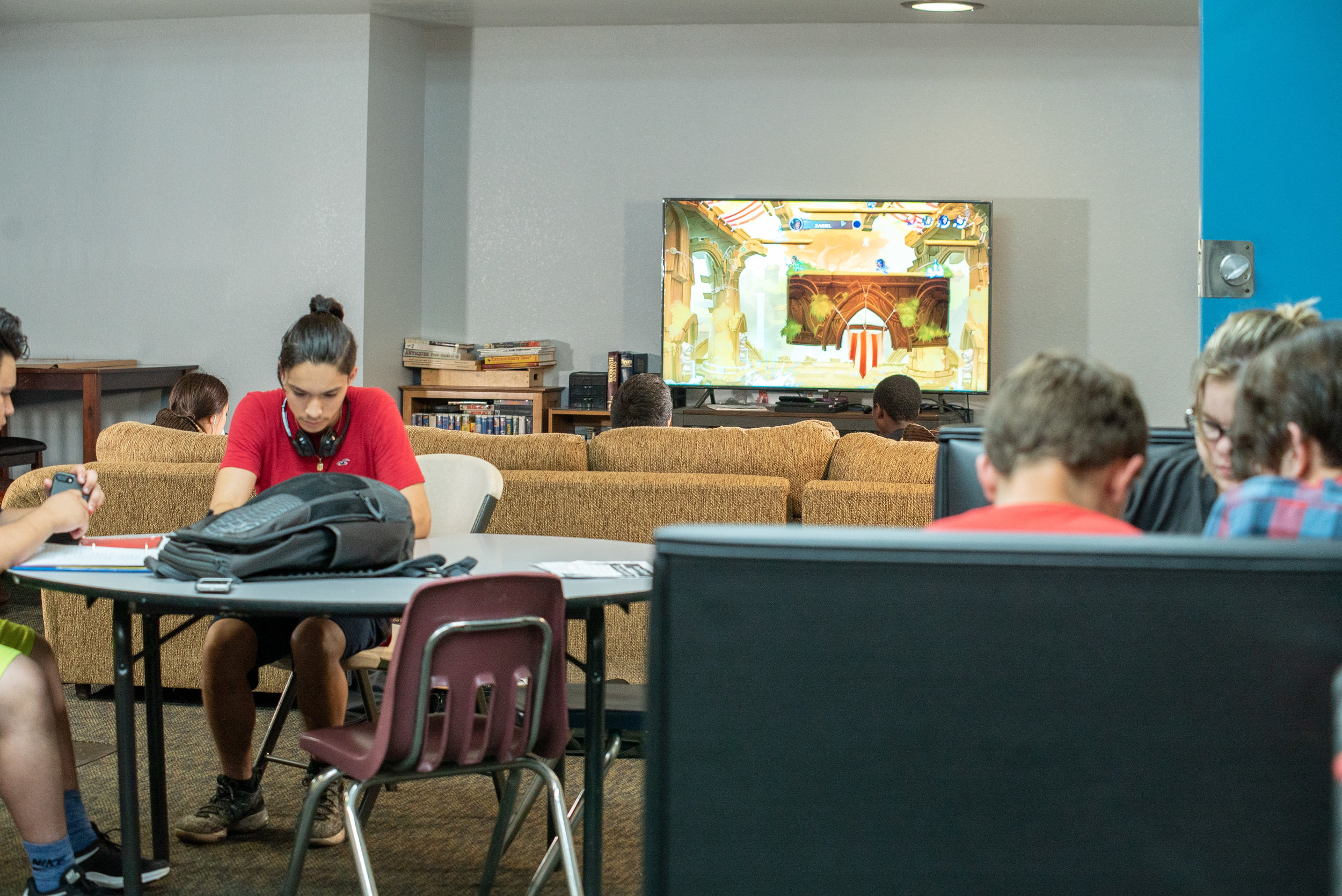 Teens take a video game break in the comfy sectional and bean bag chairs.
