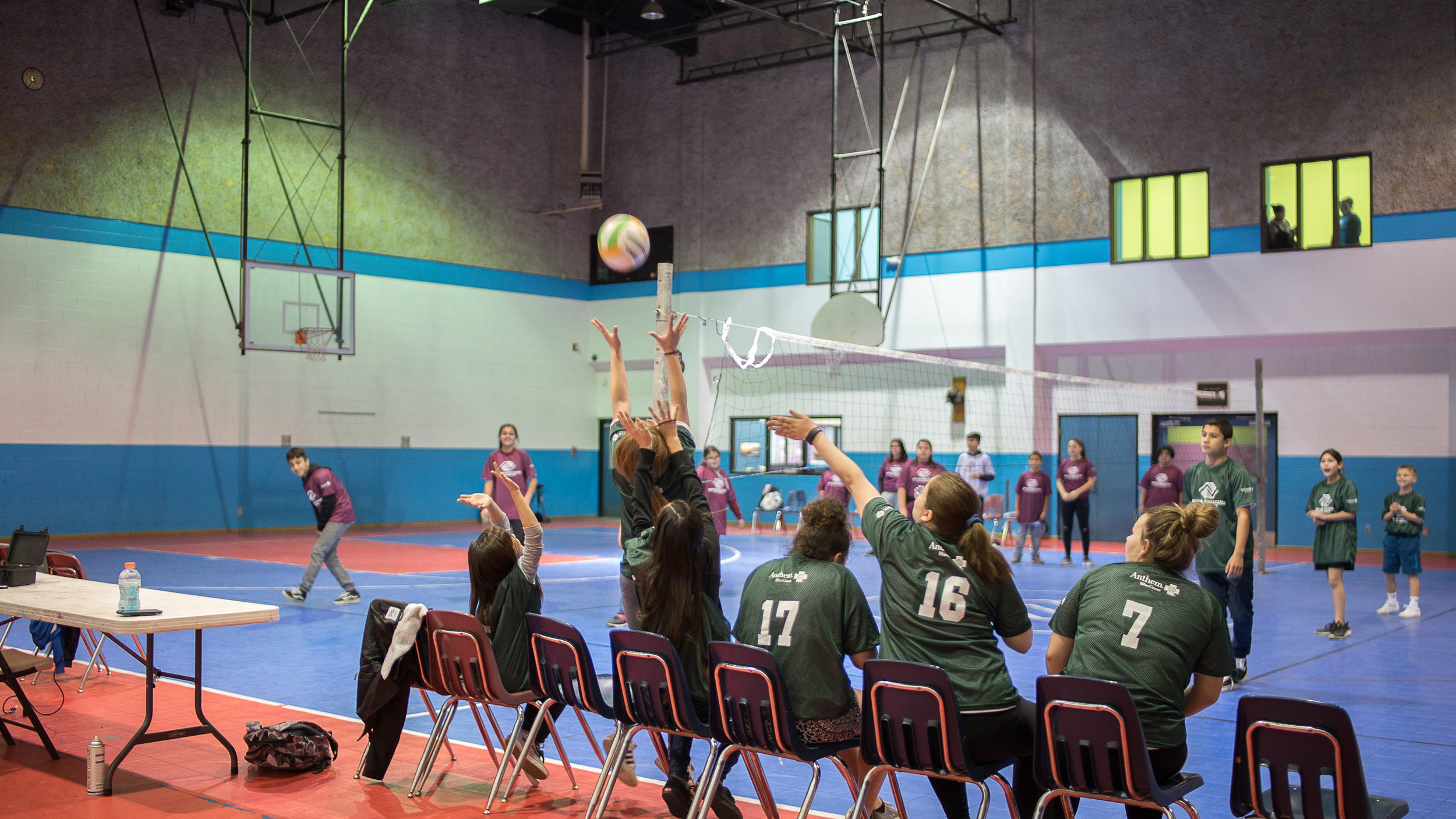 Club members compete in a volleyball tournament in the Visalia Club's Gym.