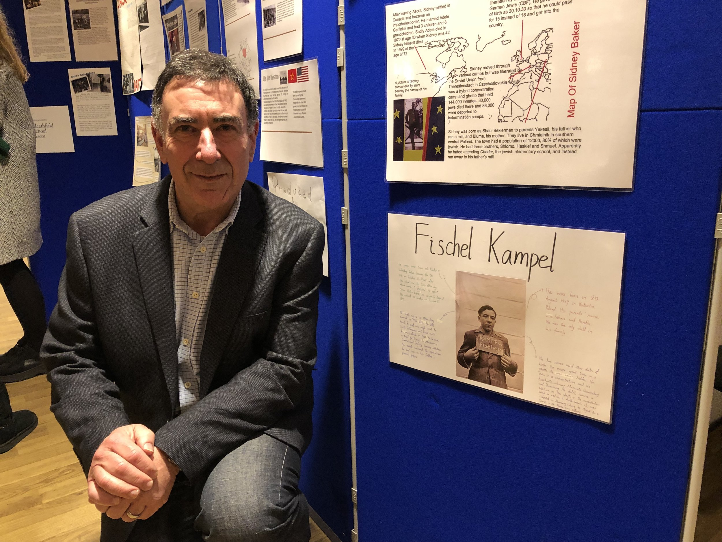 This is Lawrence Kampel next to the school project on his father made by one of the girls at St George's School in Ascot.