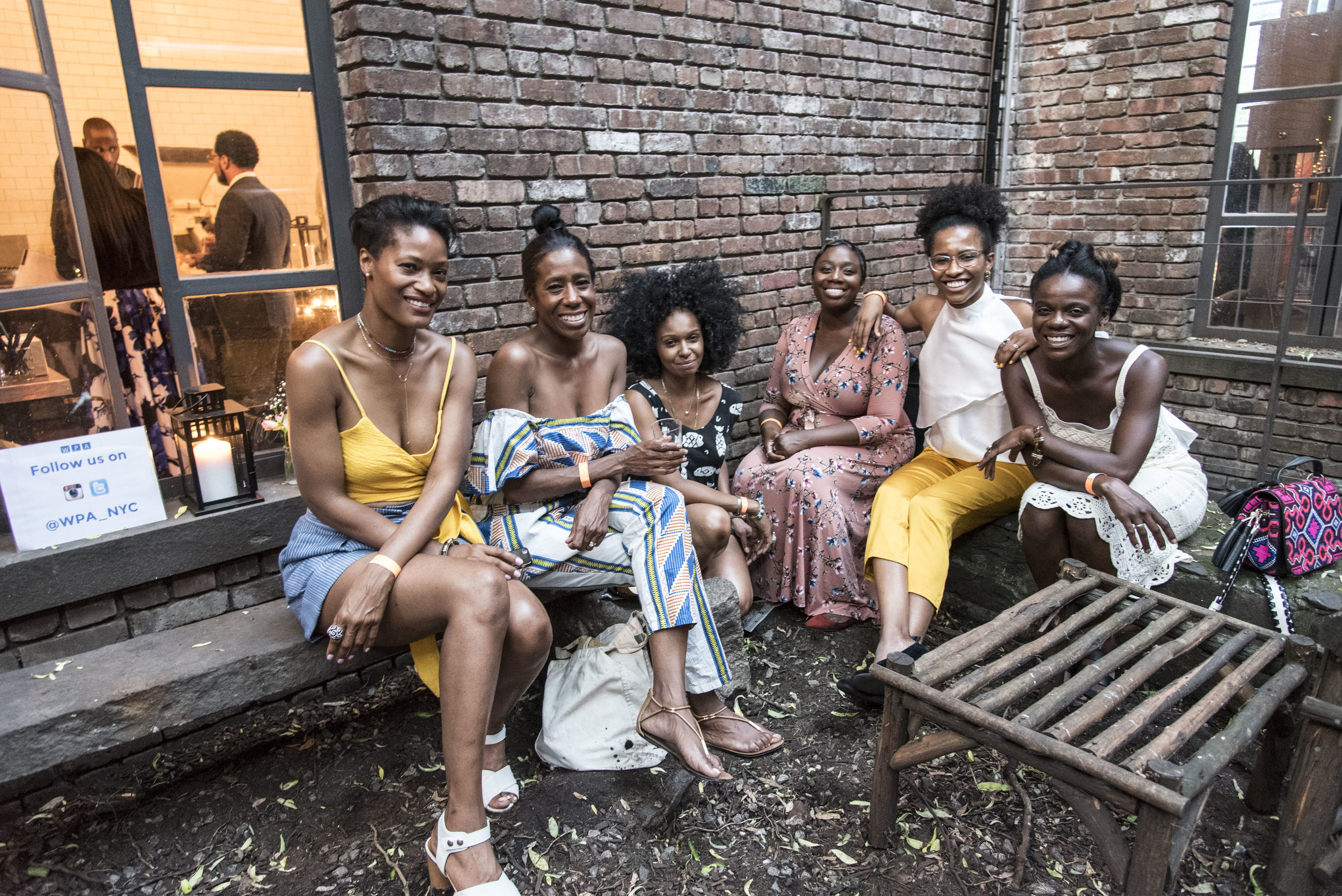 Ibada, our founder, (far right) and guests of the Women's Prison Association attend the annual WPA Summer Soiree hosted by Widow Jane Distillery in Red Hook, Brooklyn. Photo: Mambu Bayoh. Courtesy of the Women's Prison Association.