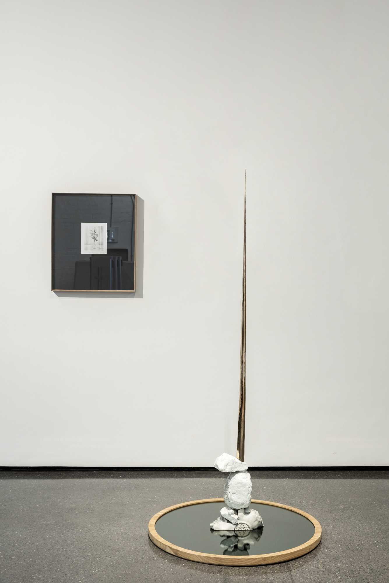 (Left)  In Loving Memory , 2019 Marsi van de Heuvel Fineliner on paper  (Right)  Untitled , 2013 Daniella Mooney Bronze, black mirror and kiaat