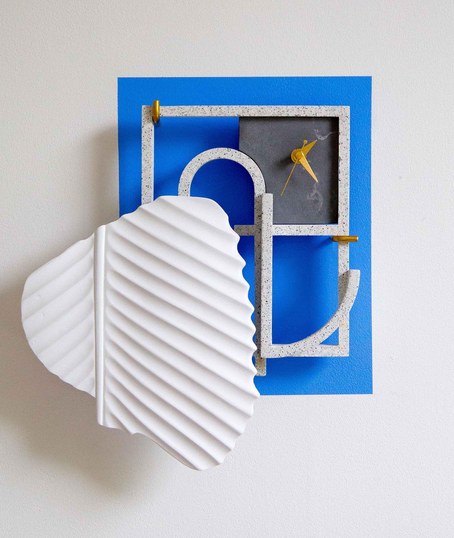 Lullaby , 2015 Jesmonite, brass, plaster, paint, clock mechanism