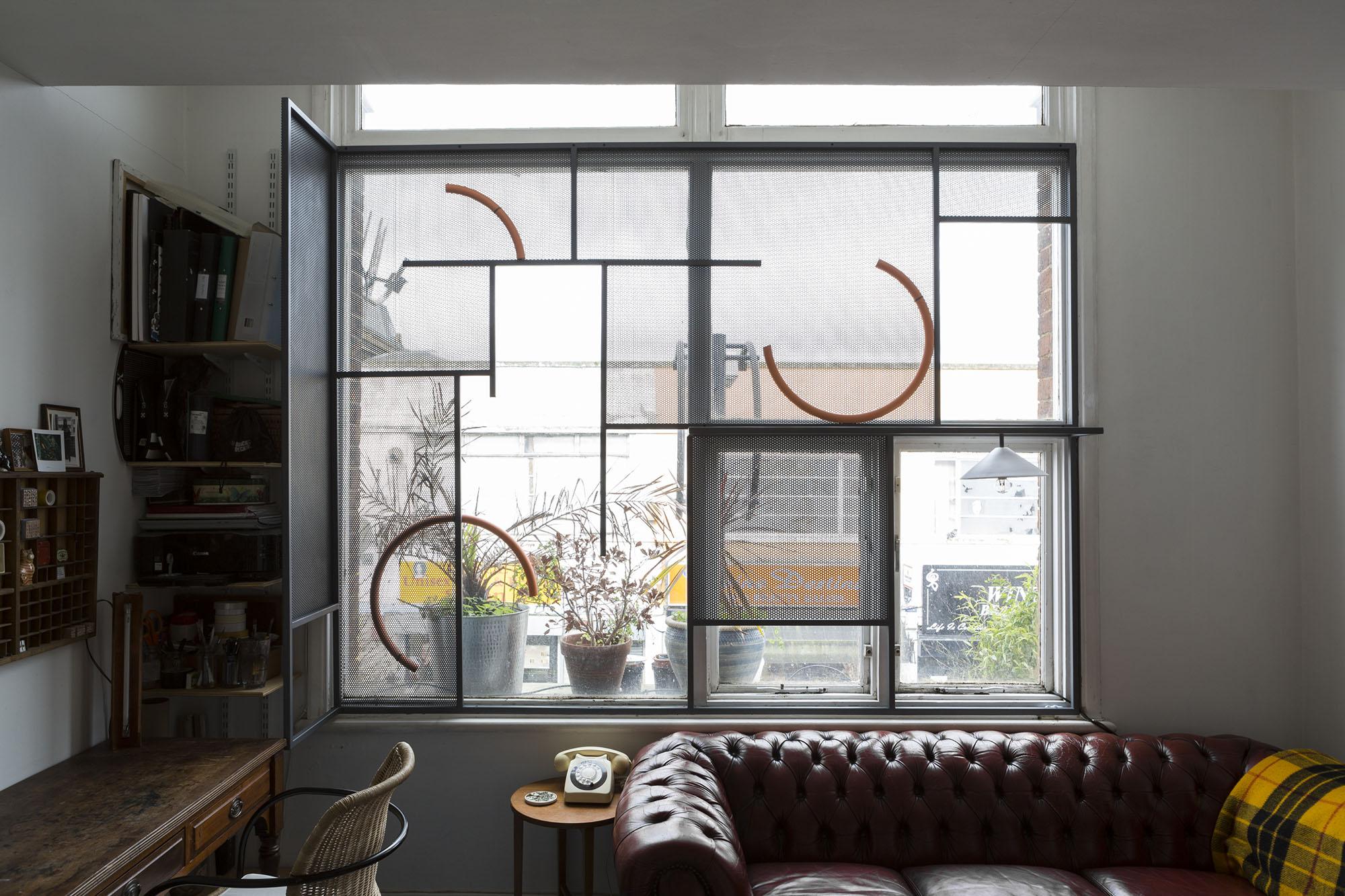 Window , 2014 Mild steel, plaster, lacquer, light bulb