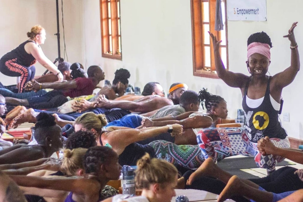 Catherine Njeri teaching the legendary Saturday community class at Africa Yoga Project Shine Center in Nairobi. Photo credits: Mona Lizuca