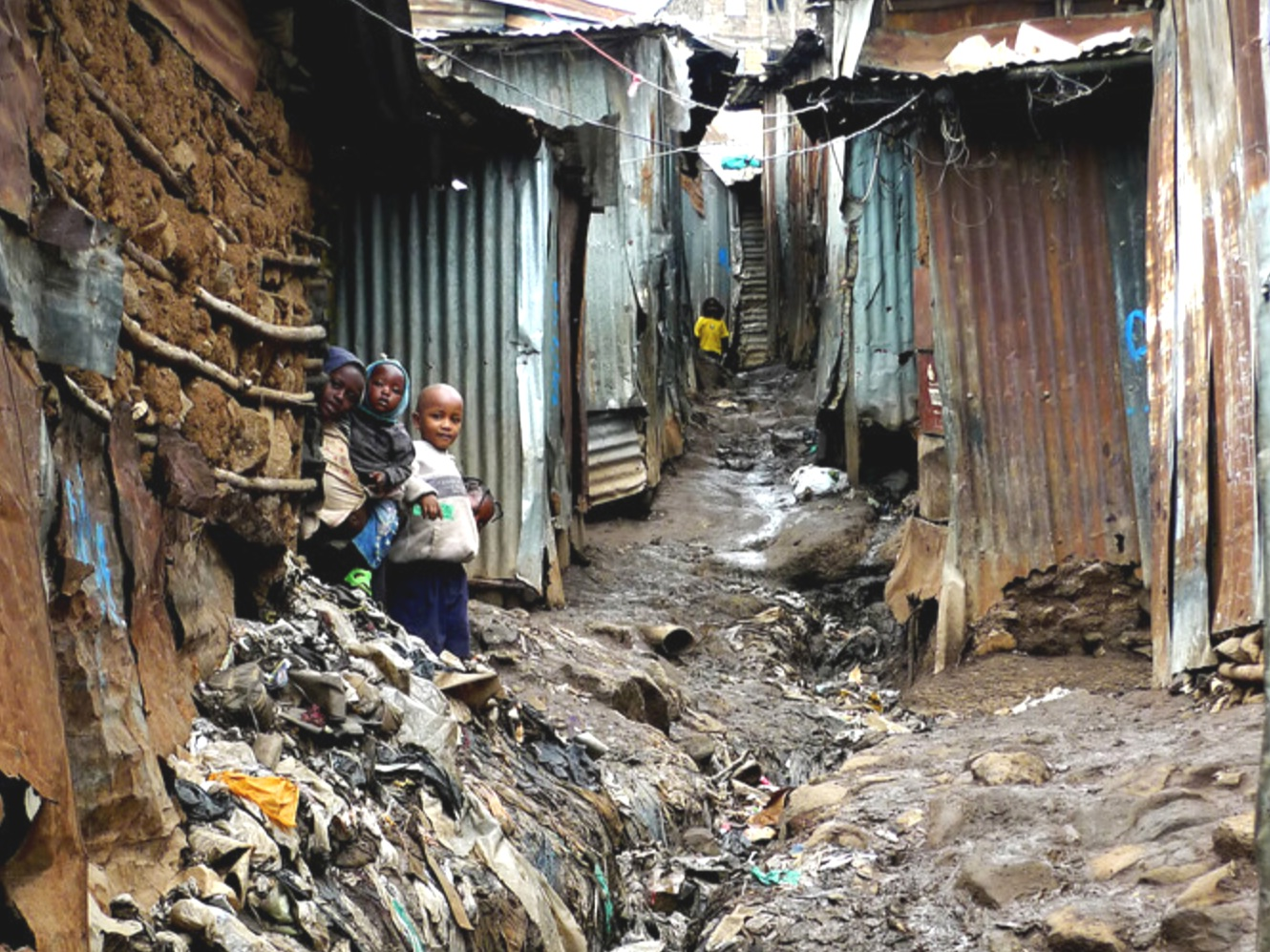 A passage in Mathare, Kenya's most overcrowded slum. Half a million people share barely 1 square kilometer in horrendous conditions. Life is set against a backdrop of poverty, anarchy, prostitution, lack of basic amenities, and a myriad of social complexities.