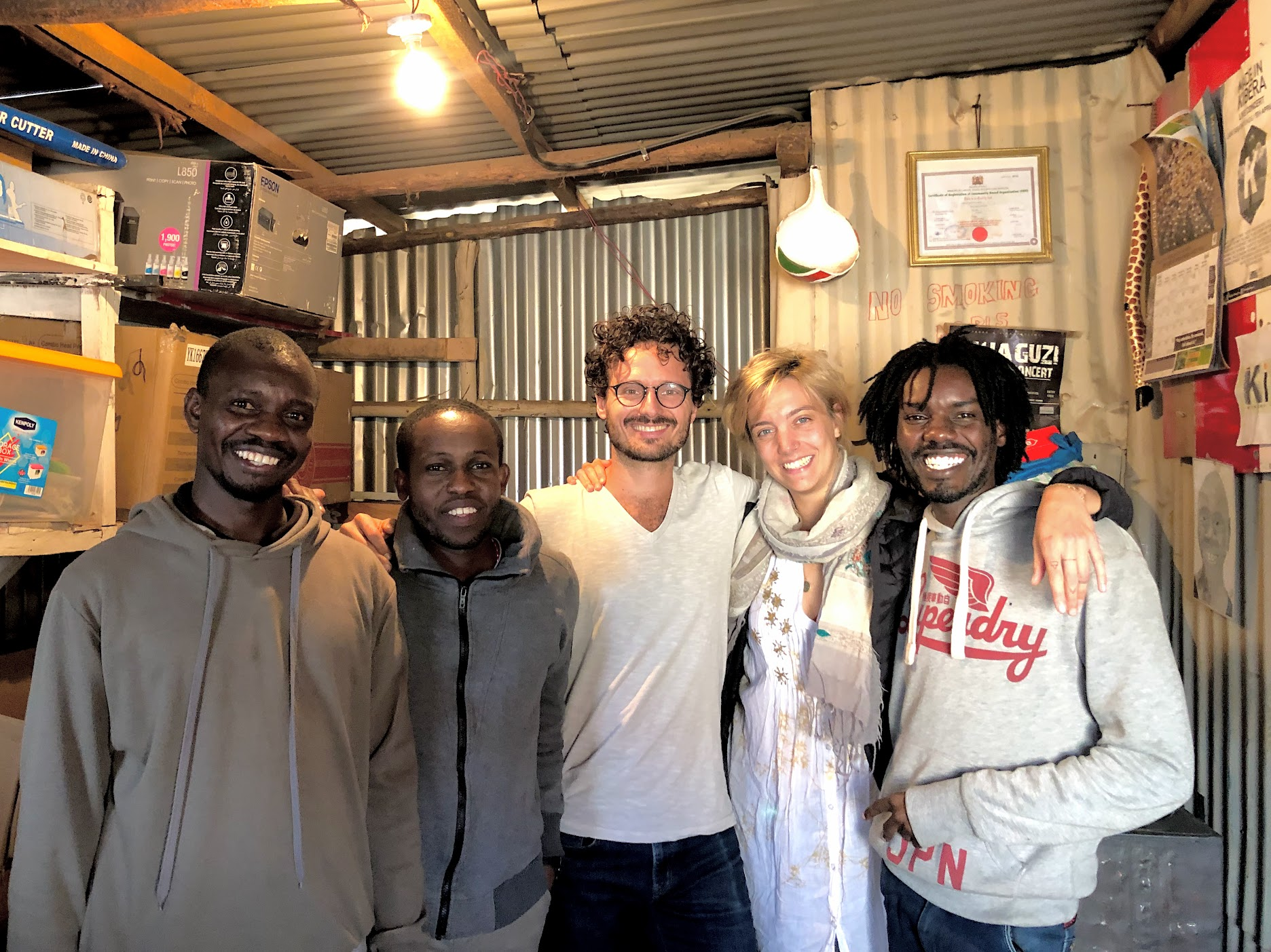 Kibera Creative Arts team, Charlotte and I during our first meeting at their office in Kibera.