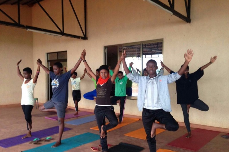 The residents of Agahozo-Shalom Youth Village during their weekly yoga class. Photo credits:  Andreas Thoma.