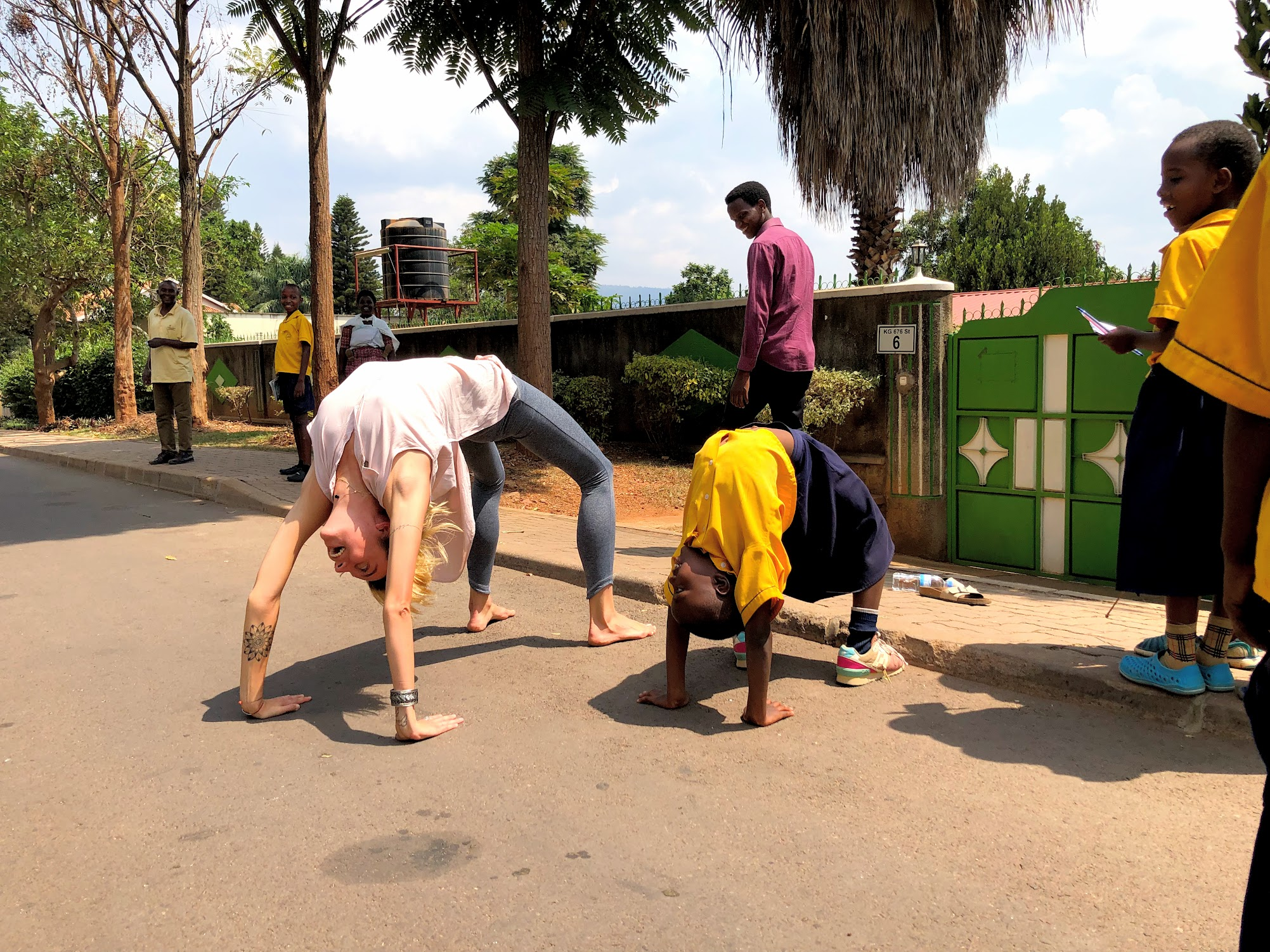 When kids practice wheel pose in the street, what else can I do but to join them?