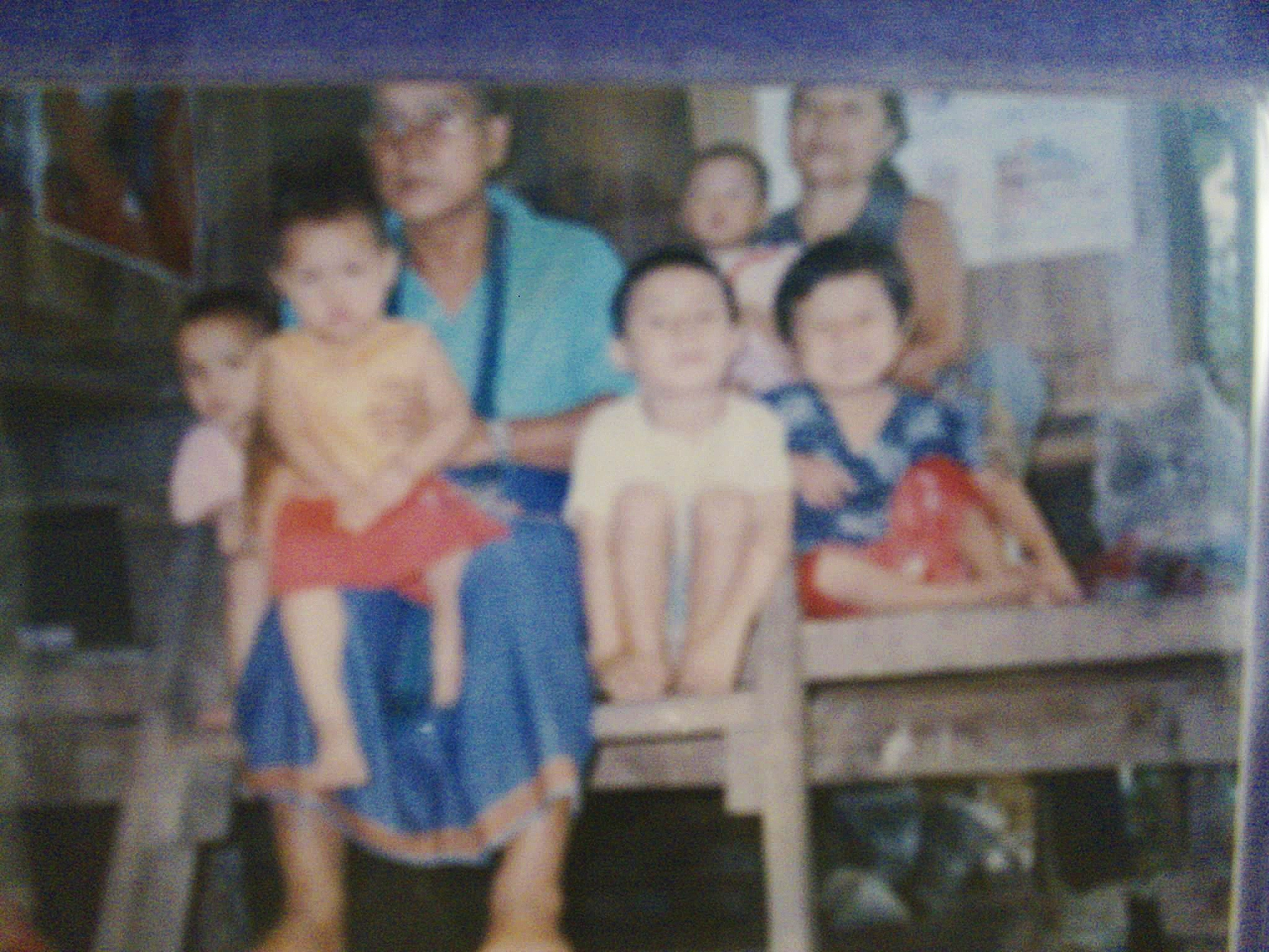 "The only remaining photo of Eh Doh Htoo and his family in the Thai refugee camp for Karen Burmese. He shared this photo with our class as part of a ""Heritage Book"" project in 2009. He graduated high school last year."