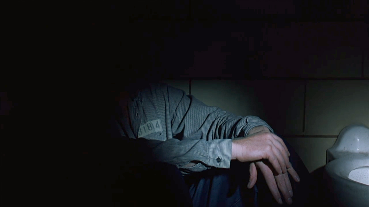 Light as a metaphor for the dark inner state of one of the antagonists - from  The Shawshank Redemption -  Castle Rock Films