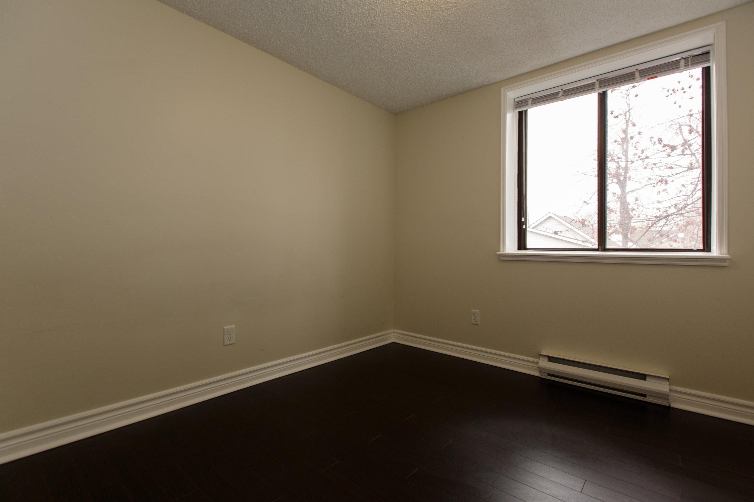 311 Queen St. _u007c_ Bedroom Photo, looking in from the hallway.jpg