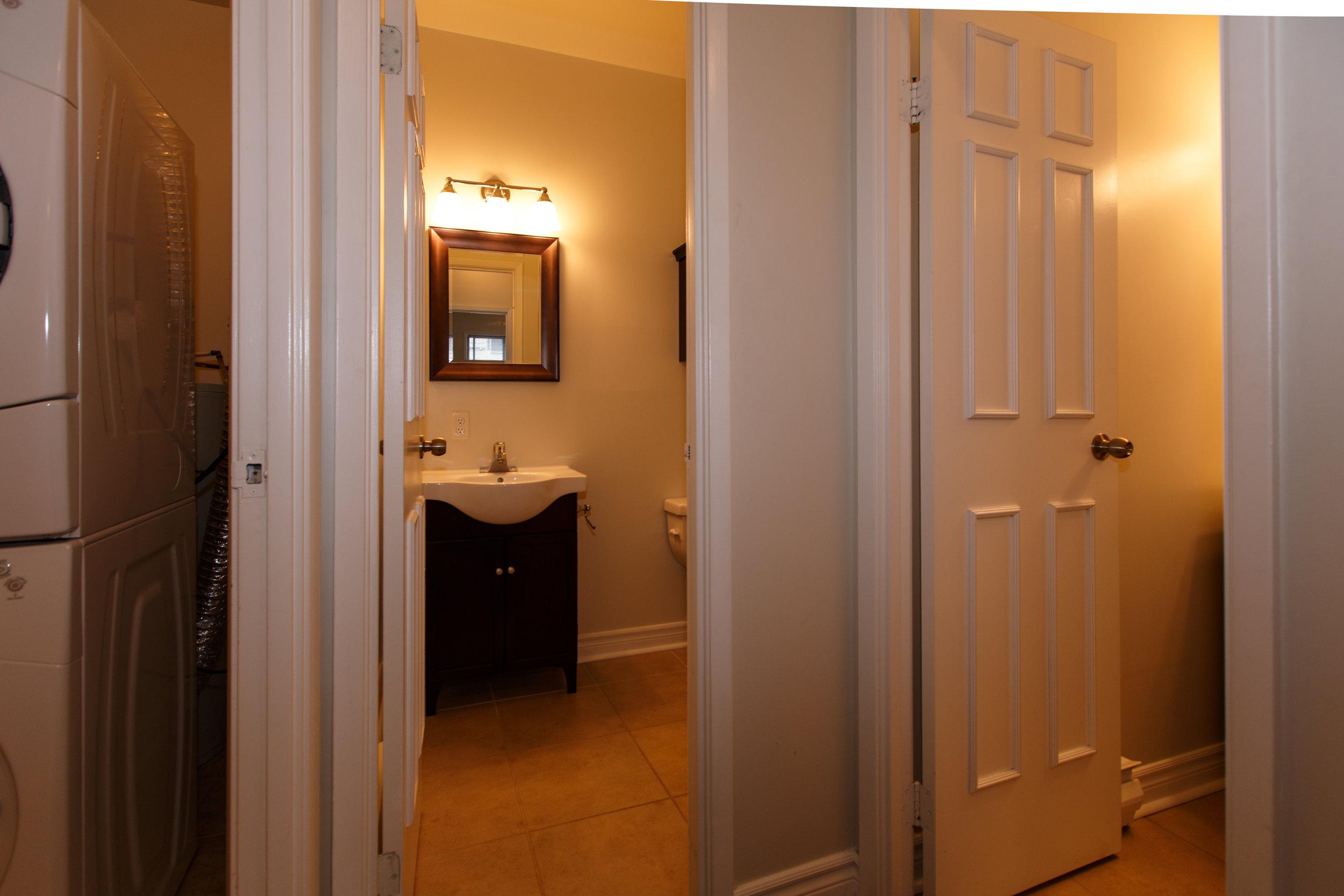 311 Queen St. _u007c_ Photo of Bathrooms, looking in from the hallway.jpg
