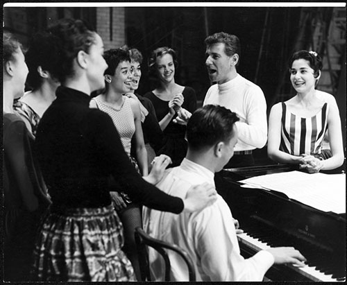 Bernstein presiding over a  West Side Story  rehearsal, with Carol Lawrence, who played Maria, at his left and lyricist Stephen Sondheim at the piano.