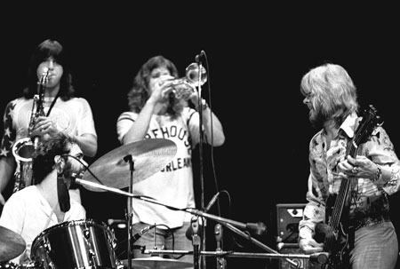Chicago's paradigm-shifting rock-band horn line featured saxophonist Parazaider and trumpeter Loughnane alongside drummer Seraphine and bassist/vocalist Cetera. Loughnane is one of three band members who were onstage at Ravinia in 1972 that will return August 10 and 11, almost exactly 47 years later.