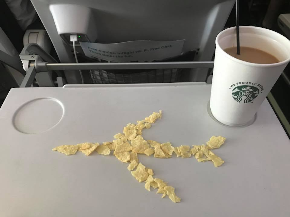 Day 193. Pringles Potato chips and Coffee on an airplane.