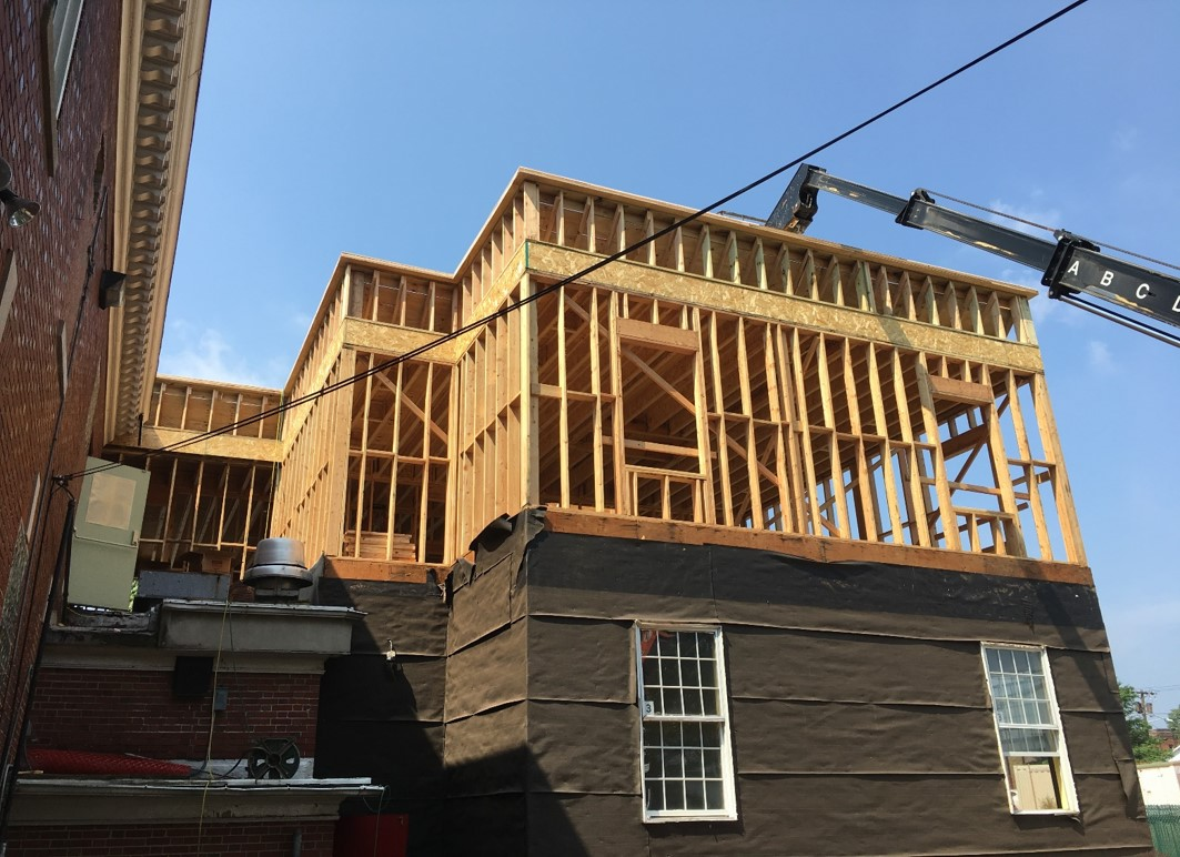 The expanded second floor is framed above our existing building.