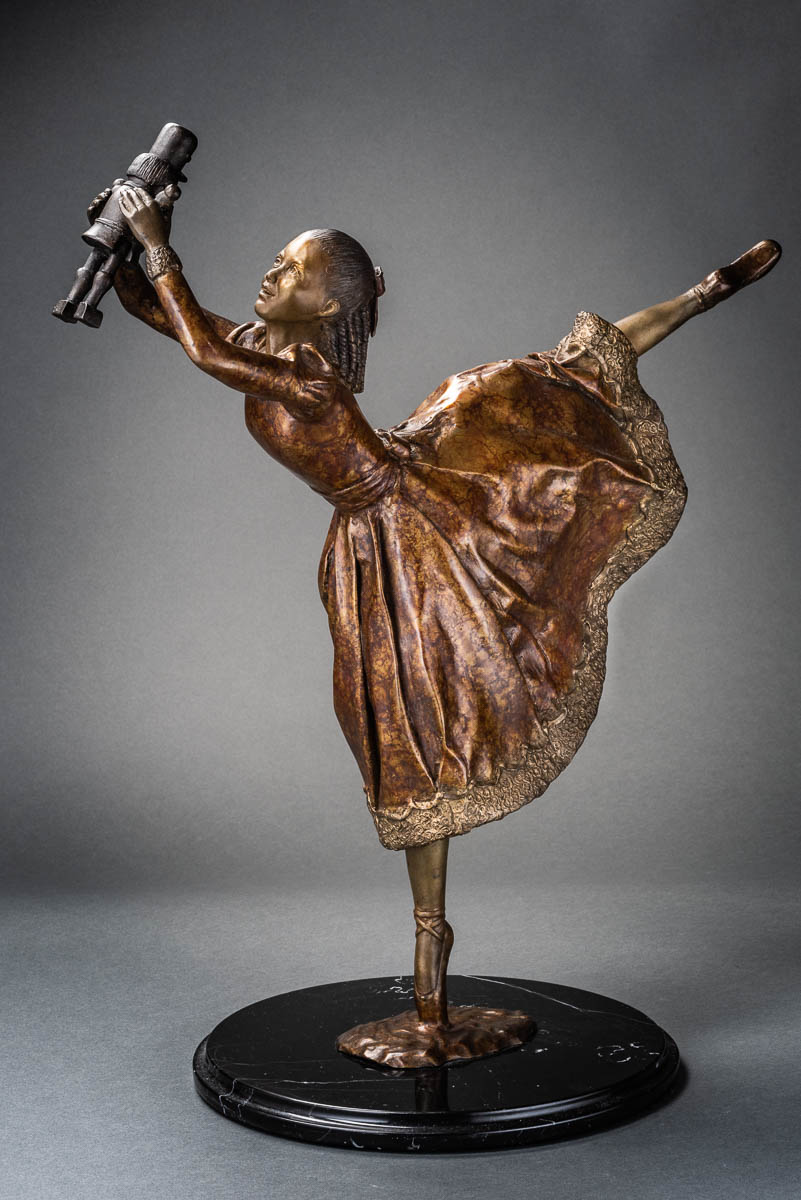 "- Clara, cast bronze, mounted on black marble, 22"" × 19"" × 6"". Limited edition of 25"