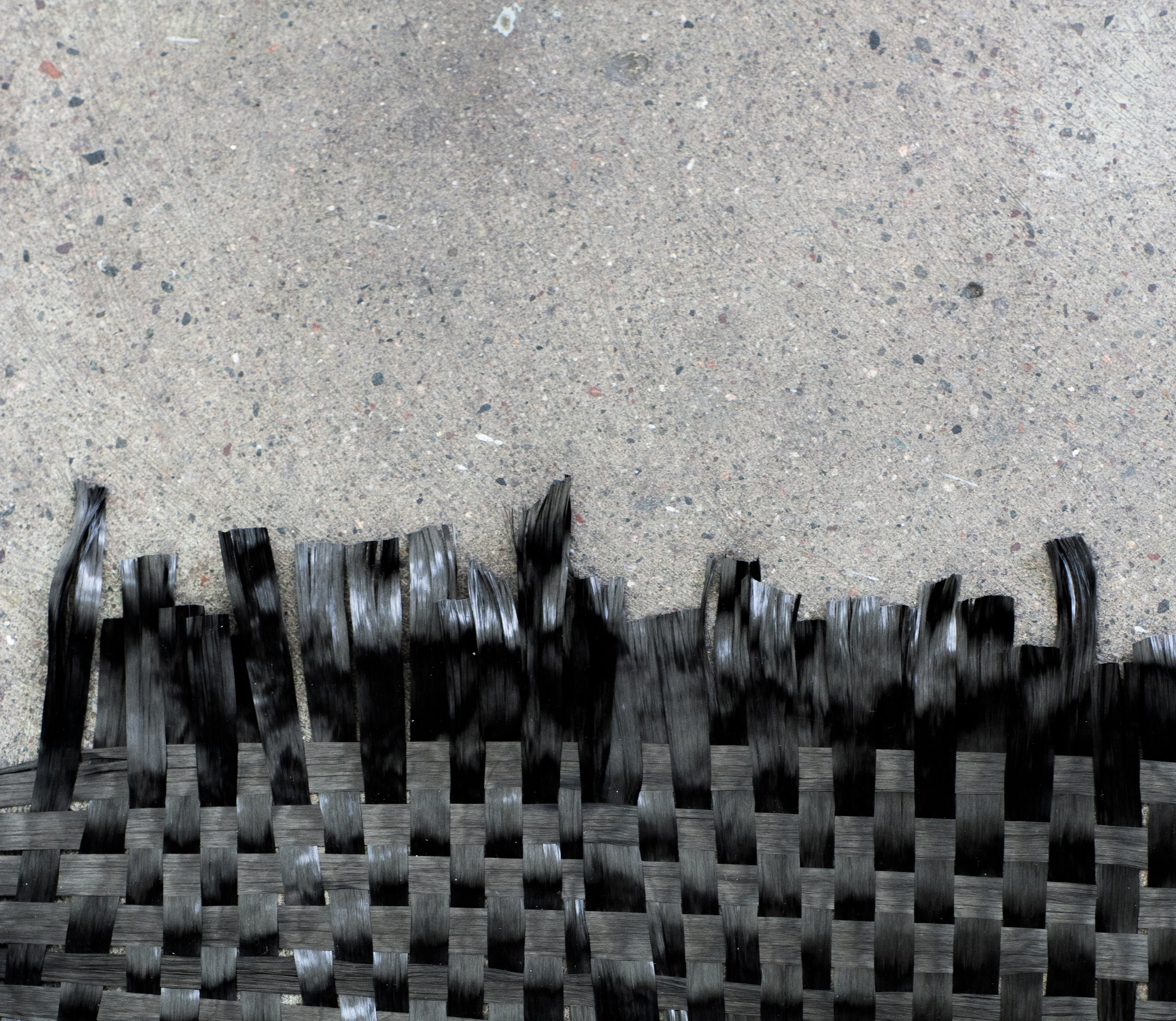 Woven activated carbon filter that can be hung as a tapestry, made into clothing, or used as a scarf to filter Volatile Organic Compounds from the air.