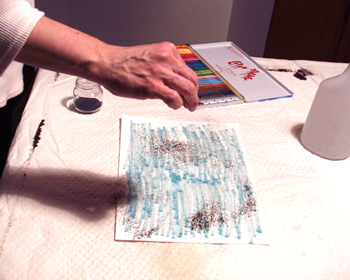 Step 2 is to sprinkle walnut ink crystals onto the wet paper.