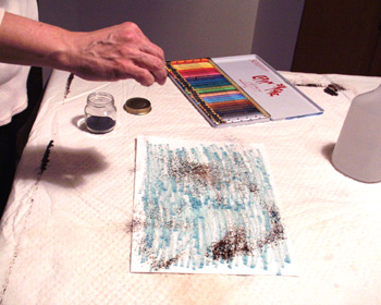Continue to sprinkle walnut ink onto the wet paper.