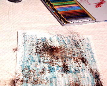 Water dissolving walnut ink on the paper.