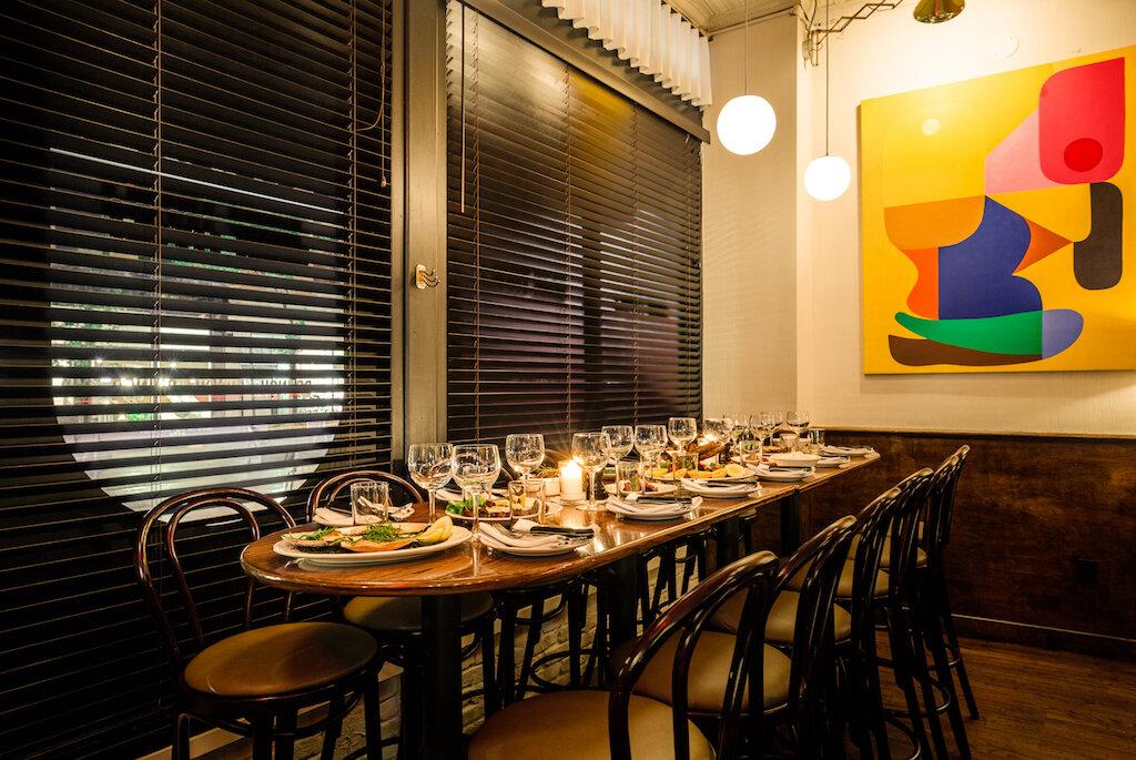 Gran Tivoli Dining Area Next to Windows and Artwork