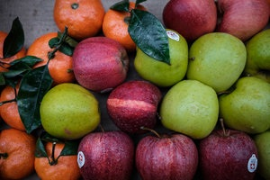 Apples and oranges together on a table.jpg