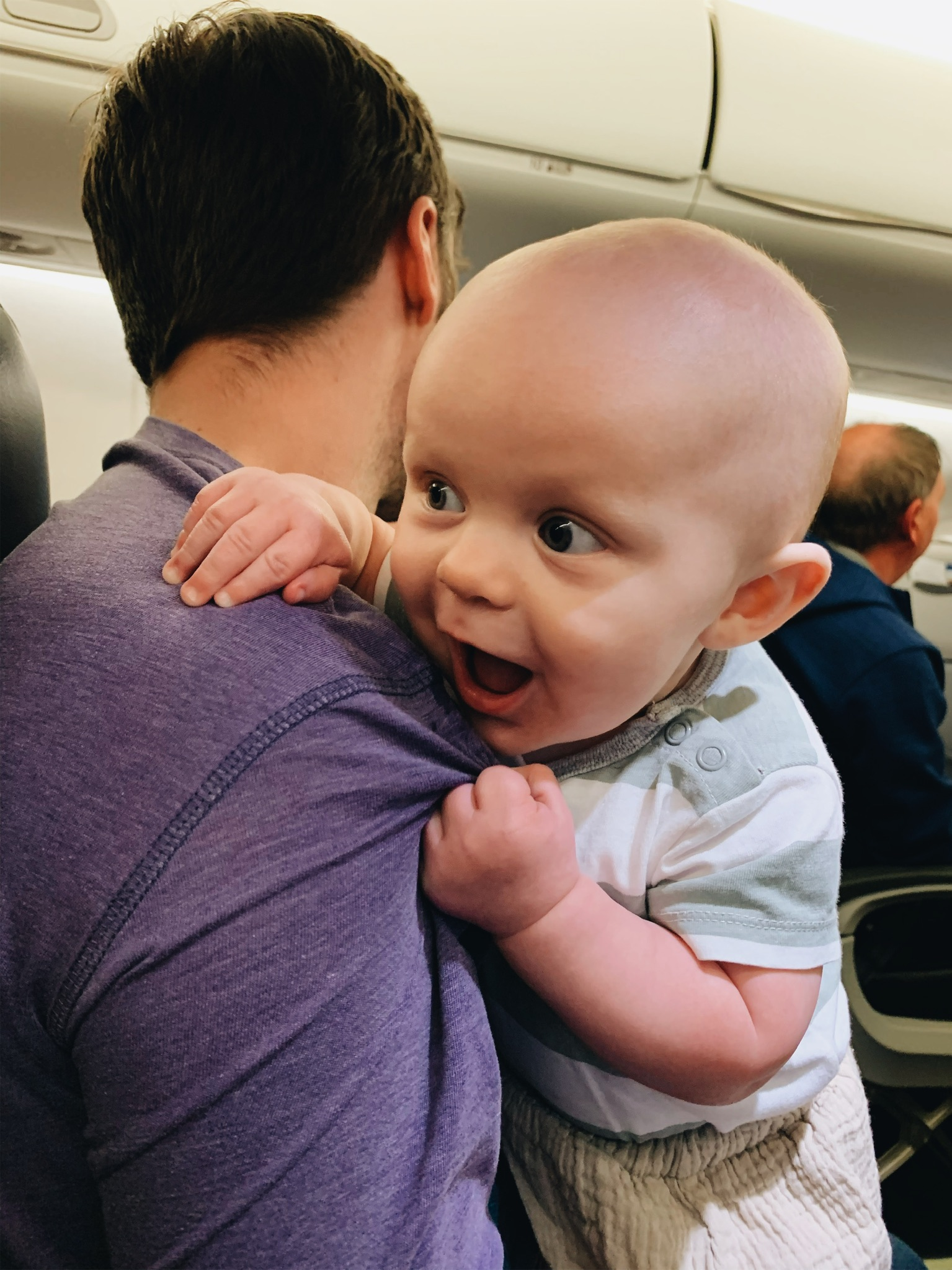 Smiling at everybody on the plane
