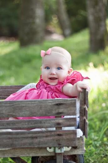 Caroline wearing a pink Netti smocked dress