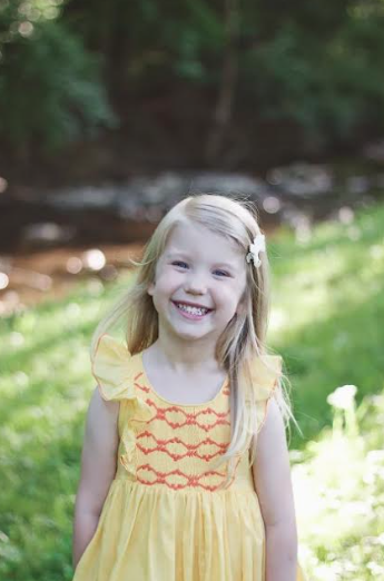 Savannah: a ray of sunshine in her Netti smocked dress