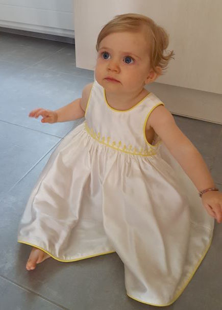 Darling baby Iris in a white handmade embroidered dress