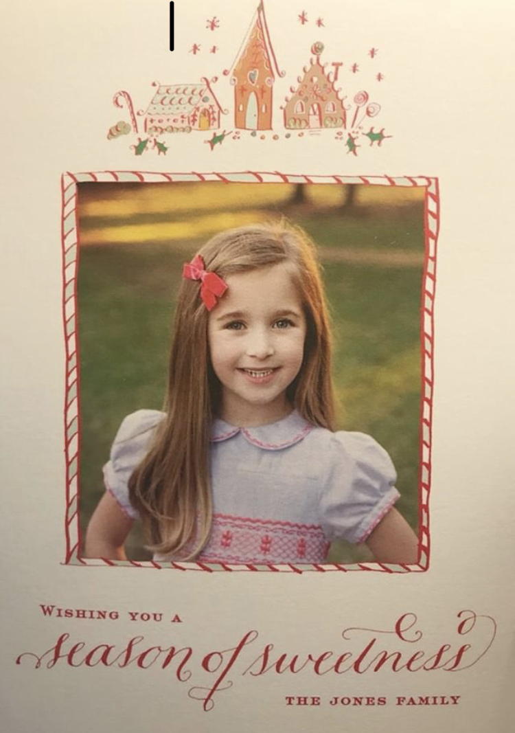 Christmas card Frazier in her handmade Princess Charlotte smocked dress