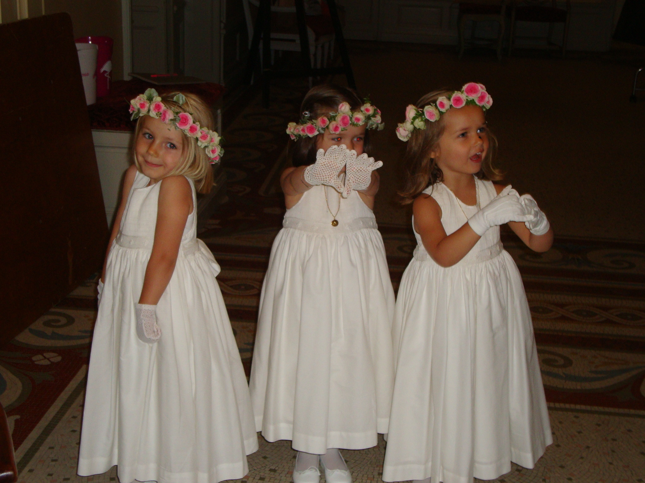 Beautiful flower girls in their white handmade smocked dress for a very chic French wedding