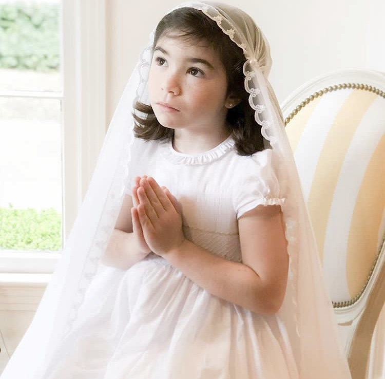 Thank you to Marie Thérèse for chosing our white Amandine smocked dress for her Holy Communion
