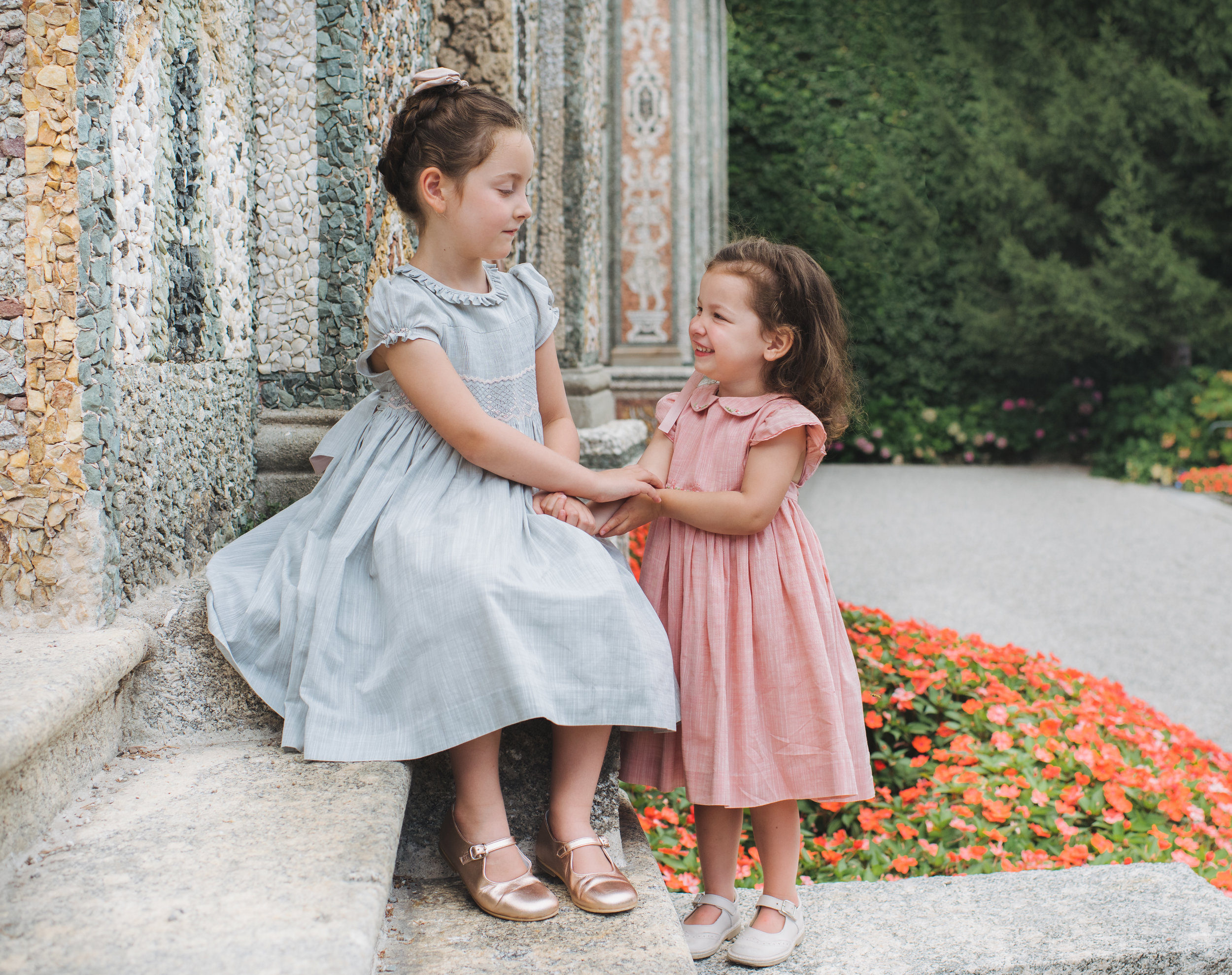 Elise and Mila wearing classic smocked dresses