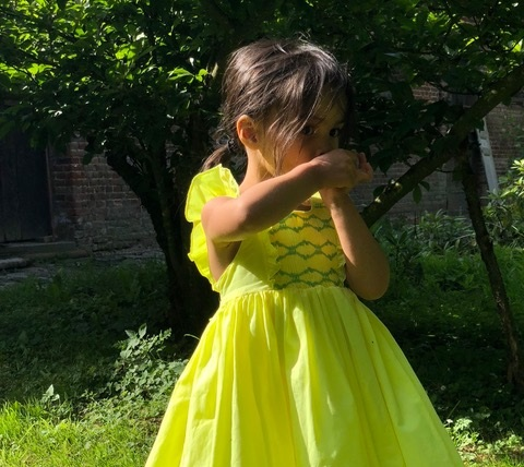 Olivia in a daffodil yellow summer smocked dress