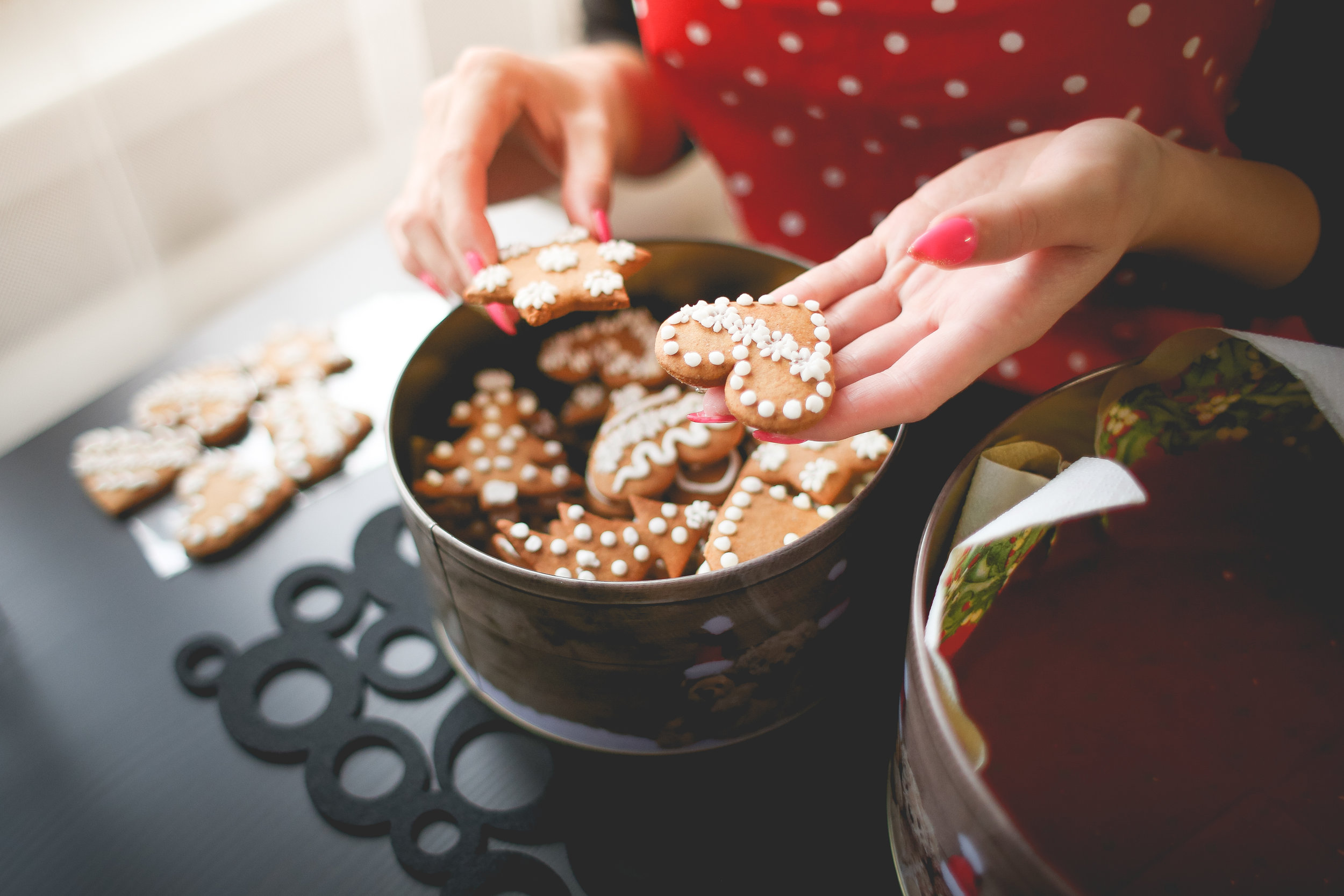 young-woman-showing-freshly-baked-christmas-cookies-picjumbo-com.jpg