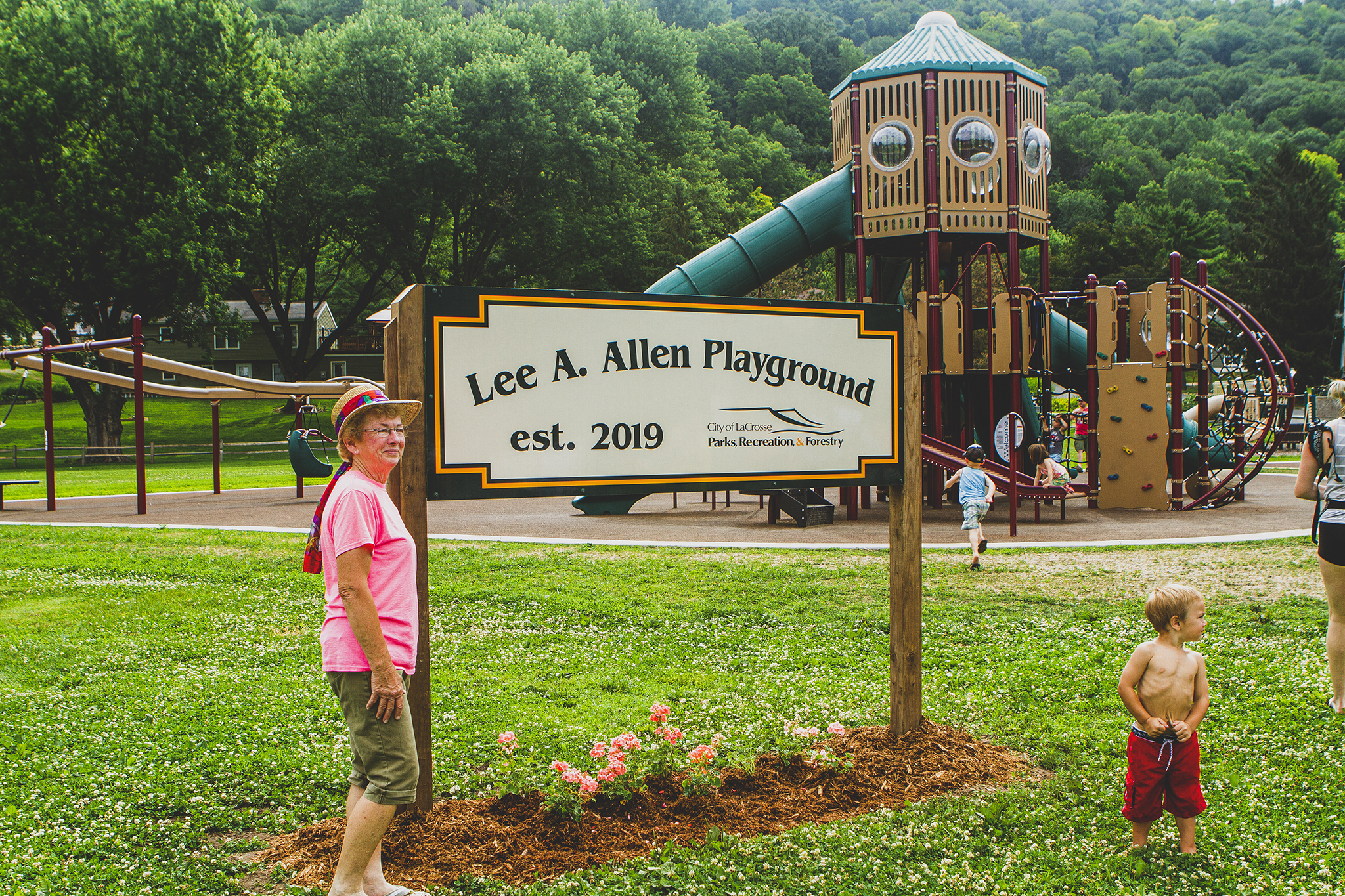 Janet Allen stands proudly at the dedication of the new Lee A. Allen Playground in La Crosse, WI